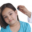 Little girl getting drops put in ear — Stock Photo #51104927