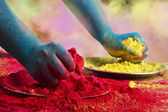 Blue colored hands holding powder paint — Stock Photo