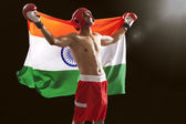 Indian male boxer with national flag — Stockfoto
