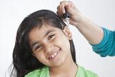 Little girl getting drops put in ear — 图库照片