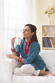 Indian woman having coffee — Stock Photo