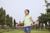 Girl with hoola hoop playing — Stock Photo