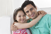 Daughter embracing Young father — Stock Photo