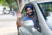 Confident Sikh man in new car — Stock Photo