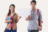 College students holding a white board — Stock Photo