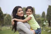 Mother holding her daughter — Stock Photo