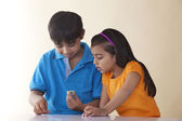 Brother and sister playing with toys — Stock Photo