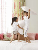 Siblings having pillow fight — Stock Photo
