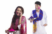 Couple with holi colors — Stock Photo