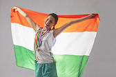 Happy young woman with medal and indian flag — Zdjęcie stockowe