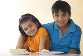 Children with sandwich at table — Stock Photo
