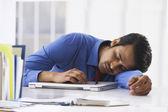 Businessman sleeping on laptop — Stock Photo