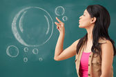 Female college student blowing the bubble — Stock Photo