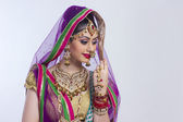 Shy Indian bride standing — Stock Photo