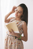 Young Indian woman reading book — Stock Photo