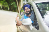 Confident Sikh man gesturing thumbs up — Stock Photo