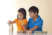 Brother and sister playing with blocks — Stock Photo