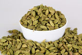 Cardamom on white cup with white background — Stock Photo