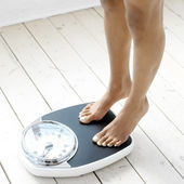 Women weighed — Stock Photo