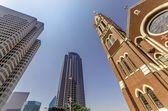 Cathedral and Skyscrapers — Stock Photo