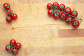 Cherry tomatoes on a kitchen board — Stock Photo