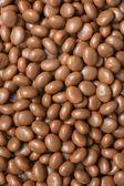 Achtergrond met chocolade snoepjes — Stockfoto
