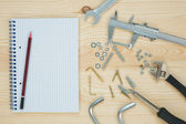 Tools on a wooden background with note — 图库照片