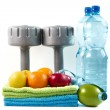 Stock Photo: Dumbbell with fruit and water on white background.