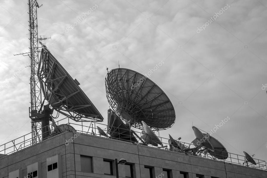 Some satellites on roof   Stock Photo #13470884