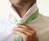 Man adjusting tie — Stock Photo