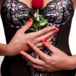 Royalty-Free Stock Photo: Women with sexy underwear holding a red rose.