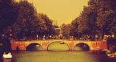 Retro bridge in Amsterdam. — Stock Photo