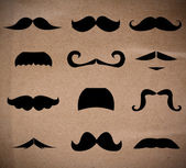 Set of mustaches isolated on recycle paper background. — Stock Photo
