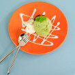 Ice-cream green tea on orange dish — Stock Photo