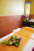 Spa massage setting with thai herbal compress stamps in spa room — Stock Photo