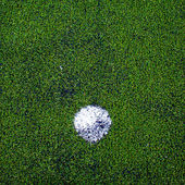 Football ( soccer ball ) in green grass field. — Stock Photo
