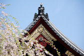 Detail on japanese temple roof against blue sky. — Stock Photo