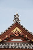 Detail on japanese temple roof against blue sky — Stock Photo