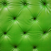 Close up luxury buttoned green leather — Stock Photo