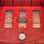 Clock on red sculture texture wall — Stock Photo
