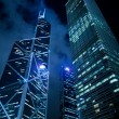Hong Kong at night, view from below. - Stock Photo