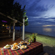 Dinner on sunset at beach in Thailand — Stock Photo