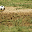 Royalty-Free Stock Photo: Old Soccer Ball. Poor school soccer field. Charity.