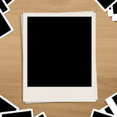 Blank photo frame on brown wooden background — Stock Photo