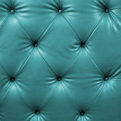 Close up cyan luxury buttoned black leather — Stock Photo