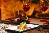Romantic salmon steak dinner with red wine — Stock Photo