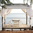 White chairs and table on a balcony with nice view to the sea — Stock Photo