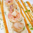 Royalty-Free Stock Photo: Fresh grilled shrimps with lemon on white plate