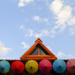 Roof house with colorful umbrella — Foto Stock
