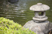 The Lantern rock of japan style in the garden — Stock Photo